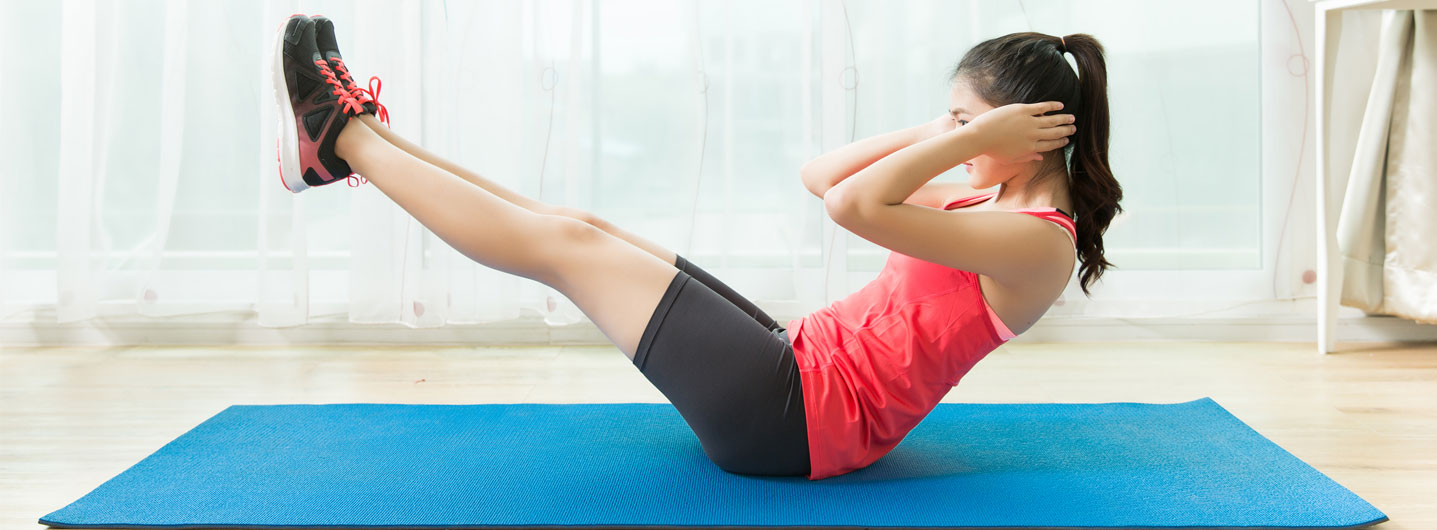 Image of woman doing a sit up during home workout
