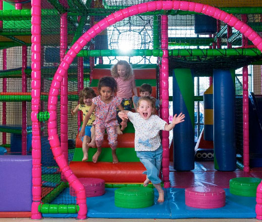 Children playing in a DL Kids soft play area.