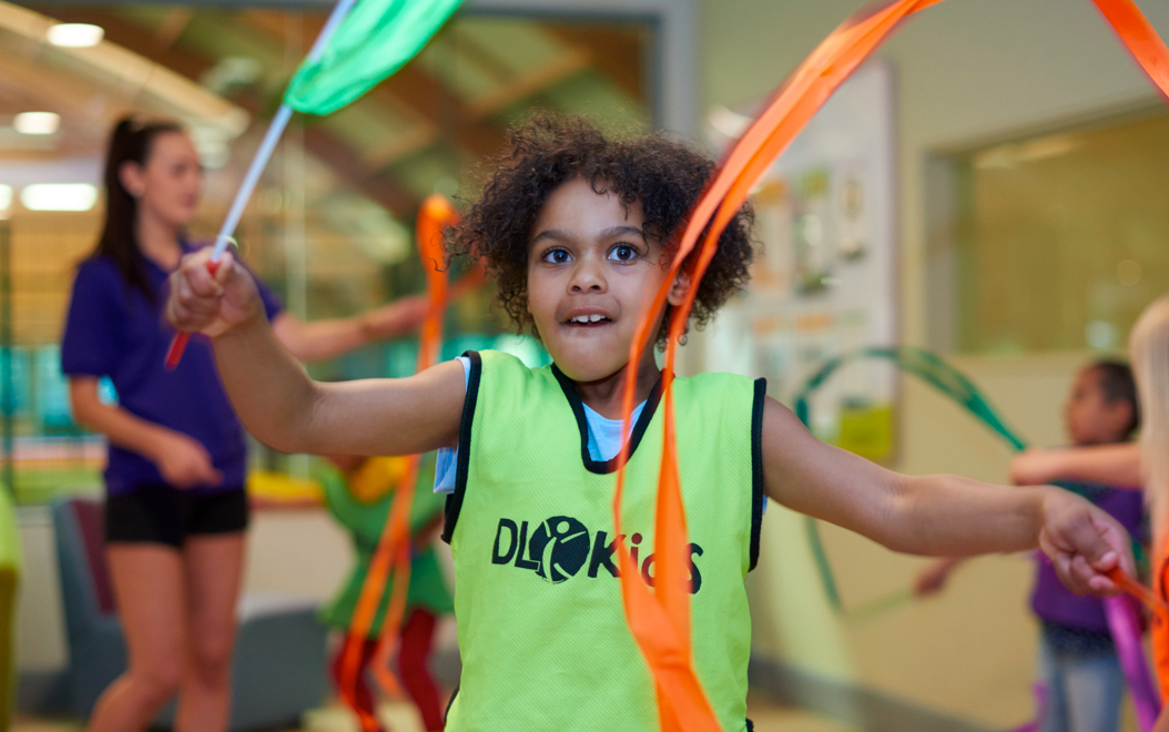 Children playing with gymastics ribbons
